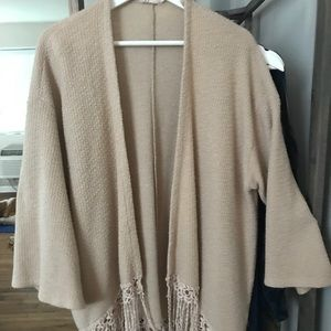 Bell sleeve sweater with fringe